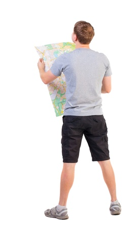 Back view of  journey  young man looking at the map. travelers man in shorts consider recreation. Rear view people collection.  backside view of person. man in outdoor activities. Isolated over white background. photo
