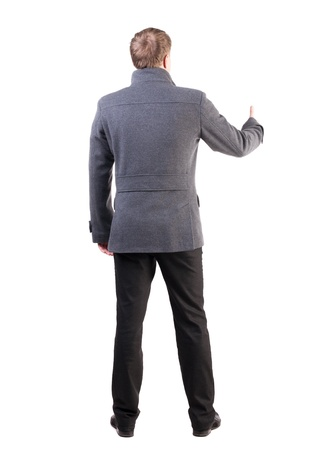Back view of  business man shows thumbs up.   Rear view people collection. cheerful office worker shows positive emotions.  backside view of person.  Isolated over white background. stylish guy in the coat shows that everything is smooth photo