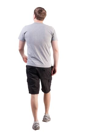 Back view of walking handsome man in shorts and sneakers.   Sports-dressed young man moves. going young guy. Rear view people collection.  backside view of person.  Isolated over white background. broad-shouldered guy is looking forward to the left photo