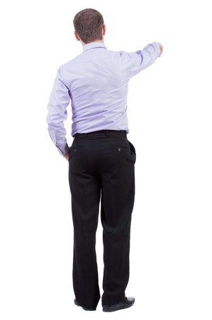powerfully: Back view of pointing business man. gesticulating young guy in black suit. Rear view people collection.  backside view of person.  Isolated over white background. office worker in a shirt and trousers powerfully indicates something Side