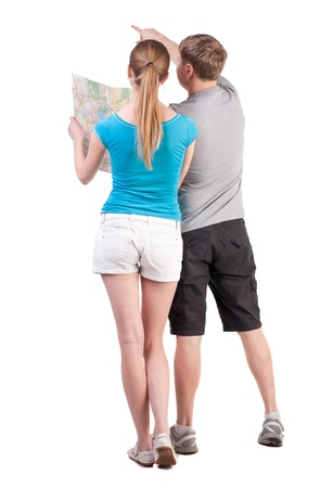 Back view journey of the young couple looking at the map. Rear view people collection.  backside view of person.  Isolated over white background. tourists on a paper map are the right way photo