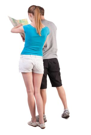 Back view journey of the young couple looking at the map. Rear view people collection.  backside view of person.  Isolated over white background. girl points a finger at the map the right way photo