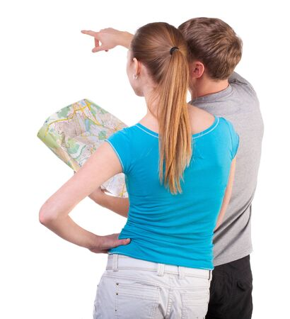Back view journey of the young couple looking at the map. Rear view people collection.  backside view of person.  Isolated over white background. Journey of the young people are looking for the right road photo