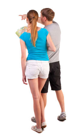 Back view journey of the young couple looking at the map. Rear view people collection.  backside view of person.  Isolated over white background. husband shows his wife found the right road on the map photo