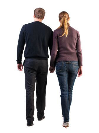 friendly people:  Back view of walking  young couple (man and woman). going beautiful friendly girl and guy in shorts together. Rear view people collection.  backside view of person.  Isolated over white background. young heterosexual couple in sweaters and jeans holding