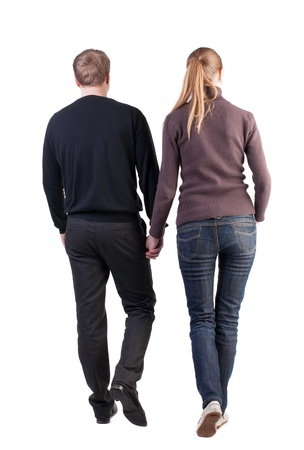 Back view of walking  young couple. going beautiful friendly girl and guy in shorts together. Rear view people collection.  backside view of person.  Isolated over white background. thoughtful couple of office workers hold hands inches up photo