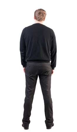 back view of Business man looks ahead. Young guy in sweater watching. Rear view people collection. backside view of person. Isolated over white background. office worker with his hands down looks ahead