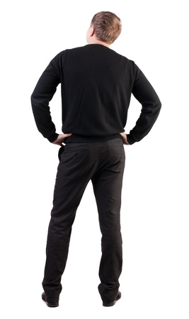 business skeptical: back view of Business man  looks ahead. Young guy in sweater watching.  Rear view people collection.  backside view of person.  Isolated over white background. skeptical office worker looking into the distance Stock Photo