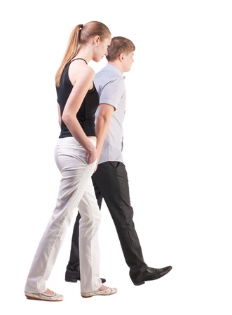 treading:  Back view of walking  young couple (man and woman).  Rear view people collection.  backside view of person.  Isolated over white background. a pair of office workers are sad about his business Stock Photo