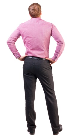 reflects: back view of Business man  looks ahead. Young guy in pink shirt watching.  Rear view people collection.  backside view of person.  Isolated over white background. broad-office worker put his hands on his hips thoughtfully reflects