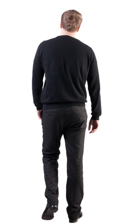 striding: back view of walking  business man.  Isolated over white background. Rear view people collection.  backside view of person.  stylish man in black sweater and pants went off Stock Photo