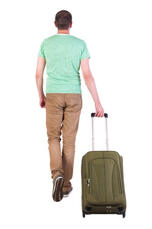 back view of walking  man  with suitcase. brunette guy in motion. backside view of person. Rear view people collection. Isolated over white background. man with a travel bag away from us into the distance photo