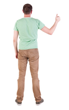 Back view of  man in green t-shirt shows thumbs up.   Rear view people collection.  backside view of person.  Isolated over white background. photo