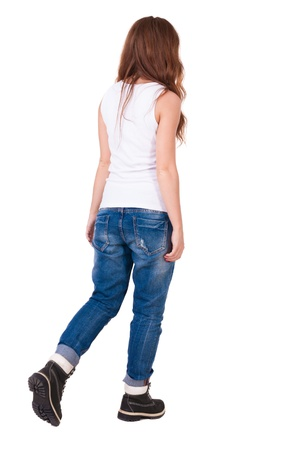 back view of walking  woman . beautiful redhead girl in motion.  backside view of person.  Rear view people collection. Isolated over white background. The girl in the mountain boots is advancing rapidly photo