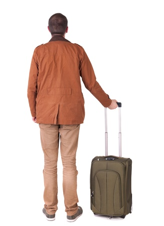 Back view of stylishly dressed man in a brown jackett with  suitcase looking up.   Standing young guy in jeans and  jacket. Rear view people collection.  backside view of person.  Isolated over white background. photo