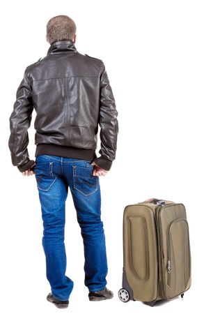 Back view of traveling man with suitcase looking up.  Isolated over white background.  Stock Photo