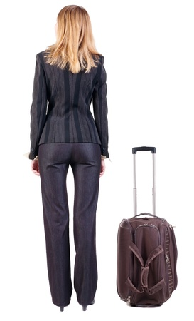 Back view of traveling business woman  with  suitcase looking up. Isolated over white background. photo