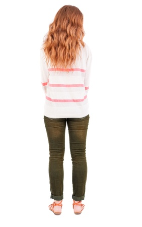 back view of standing young beautiful   woman. Isolated over white background.  photo