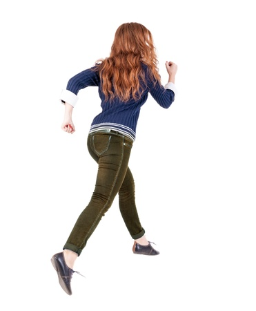 back view of jumping  woman  in  jeans.  Isolated over white background. photo