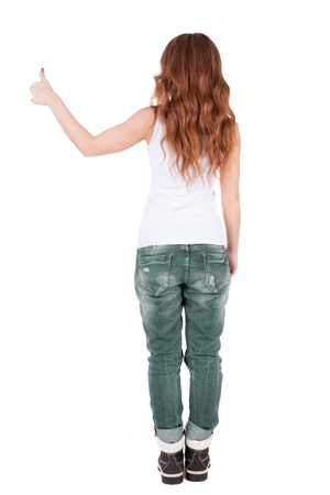 Back view of  woman thumbs up.   Isolated over white background.  photo