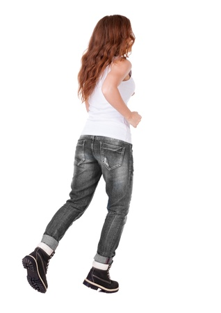 back view of jumping  woman  in  jeans.Isolated over white background. photo
