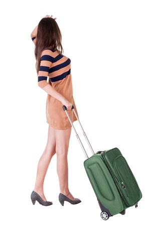 stylishly: Back view of stylishly dressed brunette woman with suitcase looking up.  Isolated over white background.