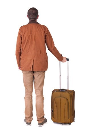 stylishly: Back view of stylishly dressed man in a brown jackett with  green suitcase looking up.  Isolated over white background.