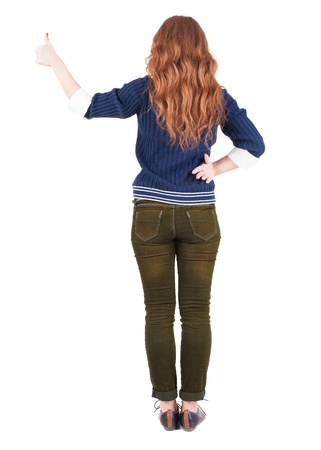 Back view of  woman thumbs up.   Rear view people collection.  backside view of person.  Isolated over white background.  photo
