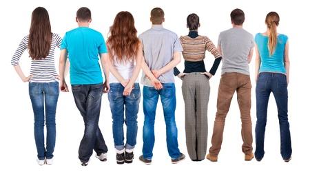 mujeres de espalda: Vista posterior del grupo de personas que buscan. Equipo Vista posterior recogida de las personas. trasero vista de la persona. Aislado sobre fondo blanco. Foto de archivo