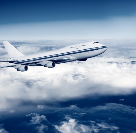 passenger airplane in the clouds  travel by air transport  flying to the top of the airliner  nobody Stock Photo