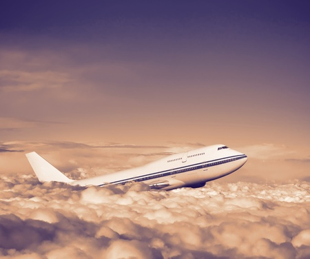 fuselage: passenger airplane in the clouds  travel by air transport  flying to the top of the airliner  nobody Stock Photo