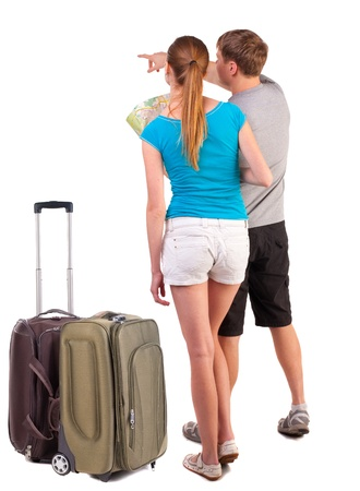 Back view journey of the young couple with suitcase looking at map. Rear view people collection.  backside view of person.  Isolated over white background. girl points a finger at the map the right way photo