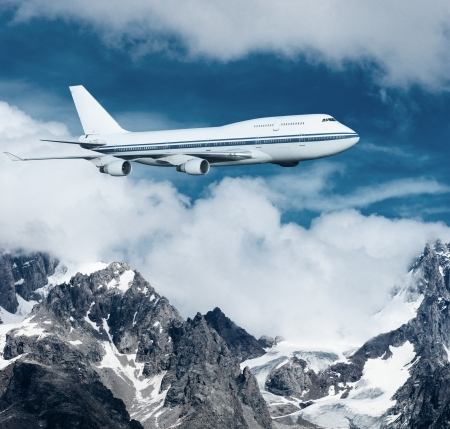 plane flying over the snow-capped mountains  passenger airplane in the clouds  travel by air transport  flying to the top of the airliner  nobody photo