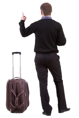 Back view of traveling business man with  suitcase pointing. Rear view people collection.  backside view of person.  Isolated over white background. photo