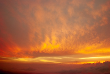 wee: wee red clouds on the sky. clouds in the light of the setting sun. clouds at dawn