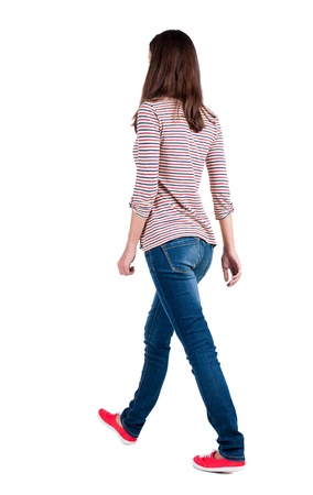looking behind: back view of walking  woman in jeans . beautiful brunette girl in motion.  backside view of person.  Rear view people collection. Isolated over white background. The girl in a striped T-shirt with sleeves podkatannymi goes ahead