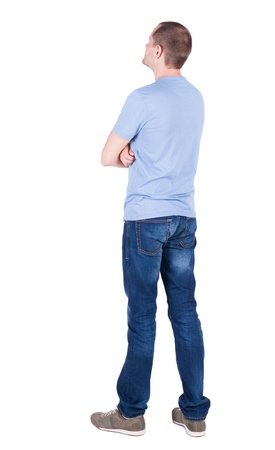 standing man: Back view of young man in t-shirt and jeans  looking.   Standing young guy. Rear view people collection.  backside view of person.  Isolated over white background.