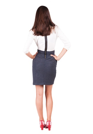 shot from behind: back view of thoughtful business woman contemplating. Young girl in suit.  Rear view people collection.  backside view of person.  Isolated over white background.