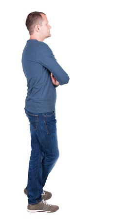 Back view of young man in t-shirt and jeans  looking.   Standing young guy. Rear view people collection.  backside view of person.  Isolated over white background. photo