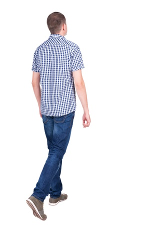 treading: Back view of going  handsome man in jeans and a shirt.  walking young guy . Rear view people collection.  backside view of person.  Isolated over white background. Stock Photo