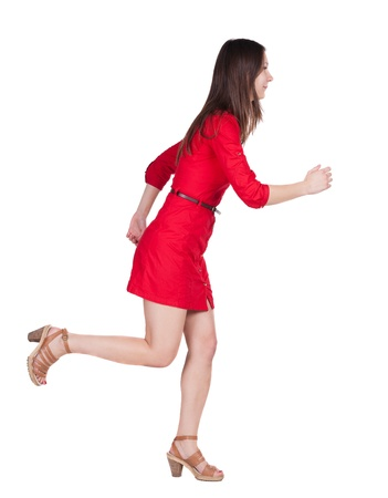 back view of running  woman  in  dress. beautiful brunette girl in motion. backside view of person.  Rear view people collection. Isolated over white background. photo