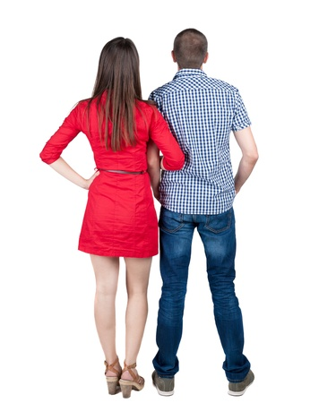 young couple pointing at wal Back view  (woman and man). looking into the distance. Rear view people collection.  backside view of person.  Isolated over white background. photo