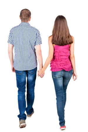 cảnh quan: Xem lại đi cặp vợ chồng trẻ (người đàn ông và phụ nữ). đi bộ đẹp cô gái thân thiện và chàng trai trong Jens. Phía sau xem bộ sưu tập người. Mặt sau của người xem. Bị cô lập trên nền trắng.