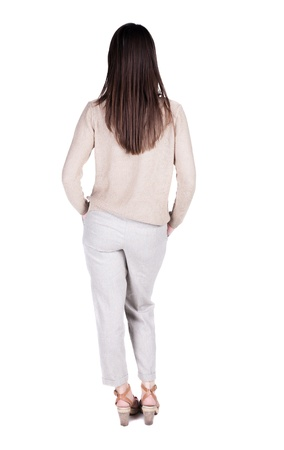back view of standing young beautiful  brunette woman. girl  watching. Rear view people collection.  backside view of person.  Isolated over white background.