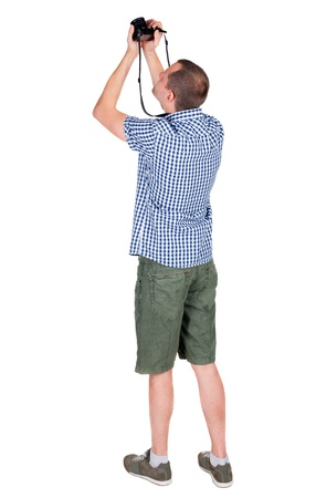 Back view of man photographing.  photographer in shorts. Rear view people collection.  backside view of person.  Isolated over white background. photo