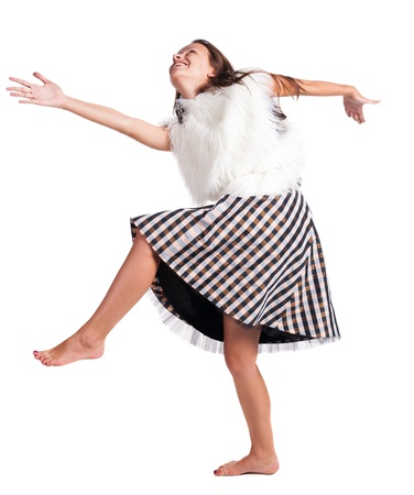 barefoot girl in a dress dances and plays the fool photo