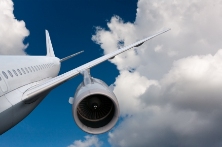 landing: airplane flying down. against the sky.  landing or crash of airplane Stock Photo