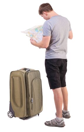 Back view of  journey  young man looking at the map. Rear view people collection.  backside view of person. man in outdoor activities. Isolated over white background. young tourist in summer clothes trying to understand the map photo