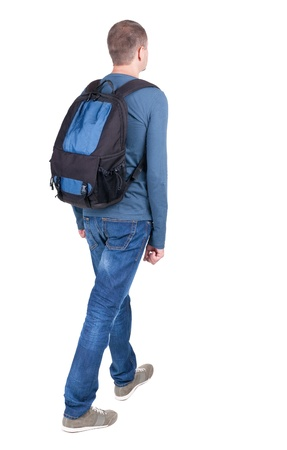 back view of walking  man  with backpack.  brunette guy in motion. backside view of person.  Rear view people collection. Isolated over white background.  photo