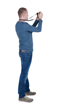 in behind: Back view of man photographing.  photographer in jeans. Rear view people collection.  backside view of person.  Isolated over white background.
